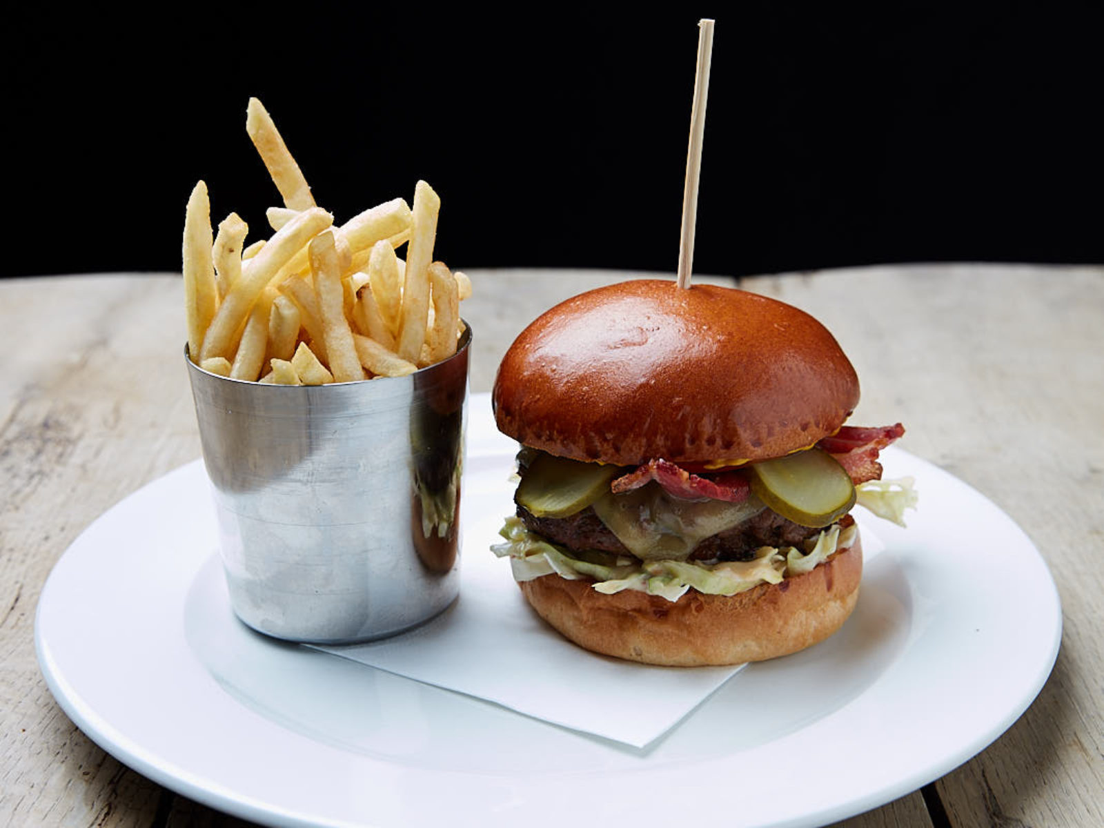 Our delicious beef burger with bacon and skinny fries